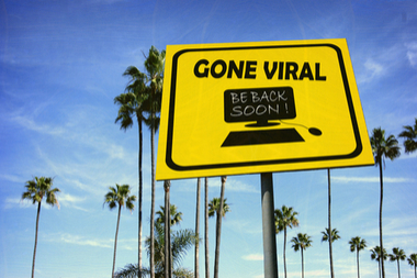 aged and worn vintage photo of gone viral sign at beach with palm trees